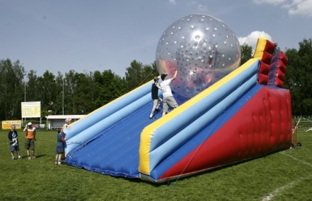 Pushing Zorbing Ball Down An Inflatable Slide