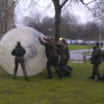 People In Army Fancy Dress Doing BodyZorbing