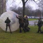 People In Army Fancy Dress Doing BodyZorbing