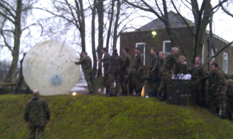 People Dressed In Army Style To Do Zorbing