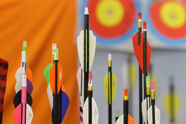 Colourful Arrow Heads With Target In Background
