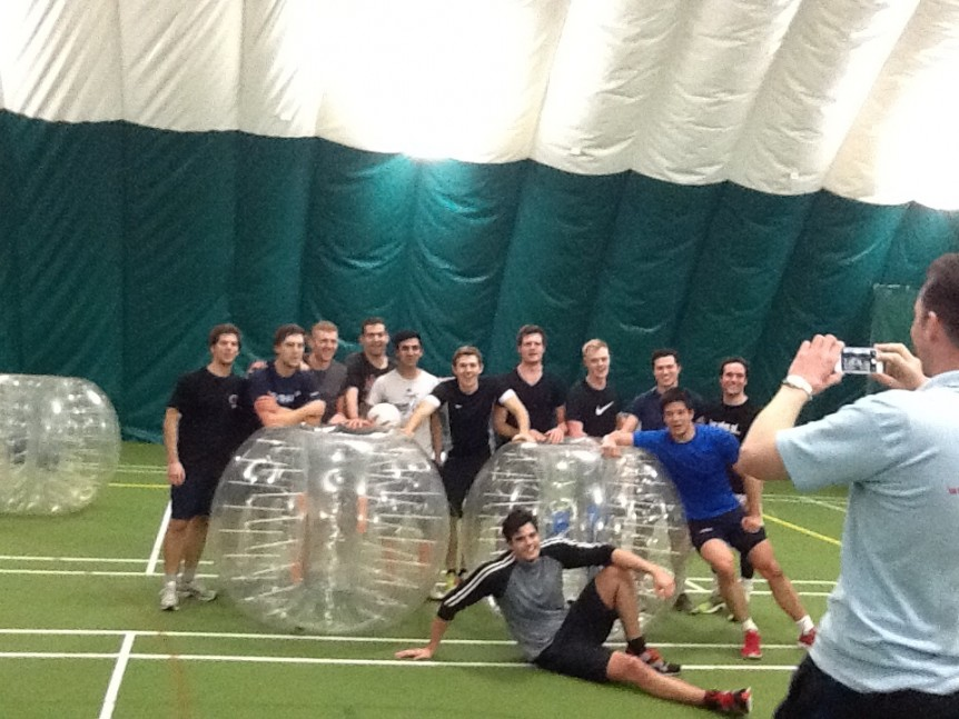 Team Of Boys Playing Bubble Football