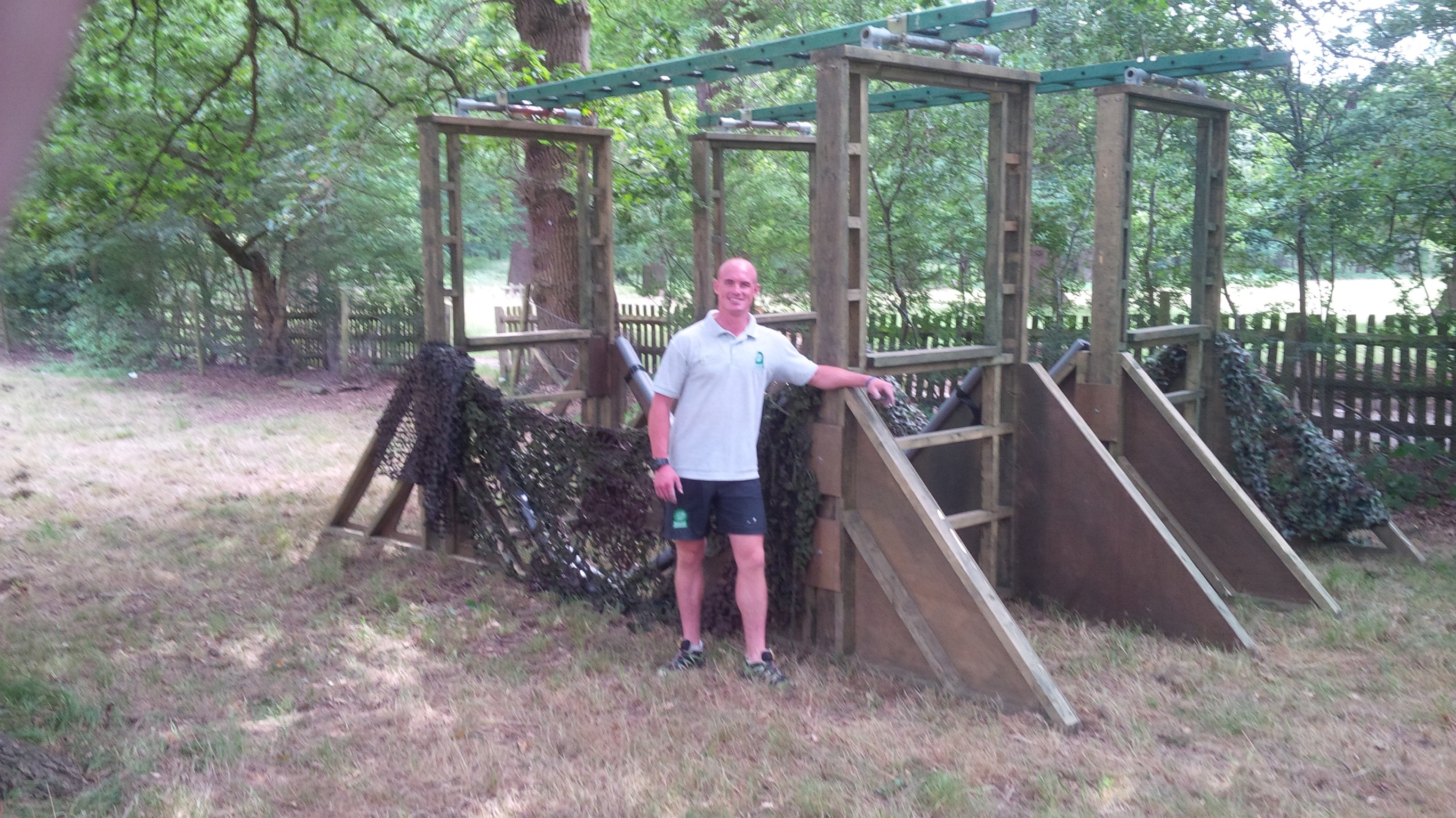 Person Standing With Obstacle Course Equipment
