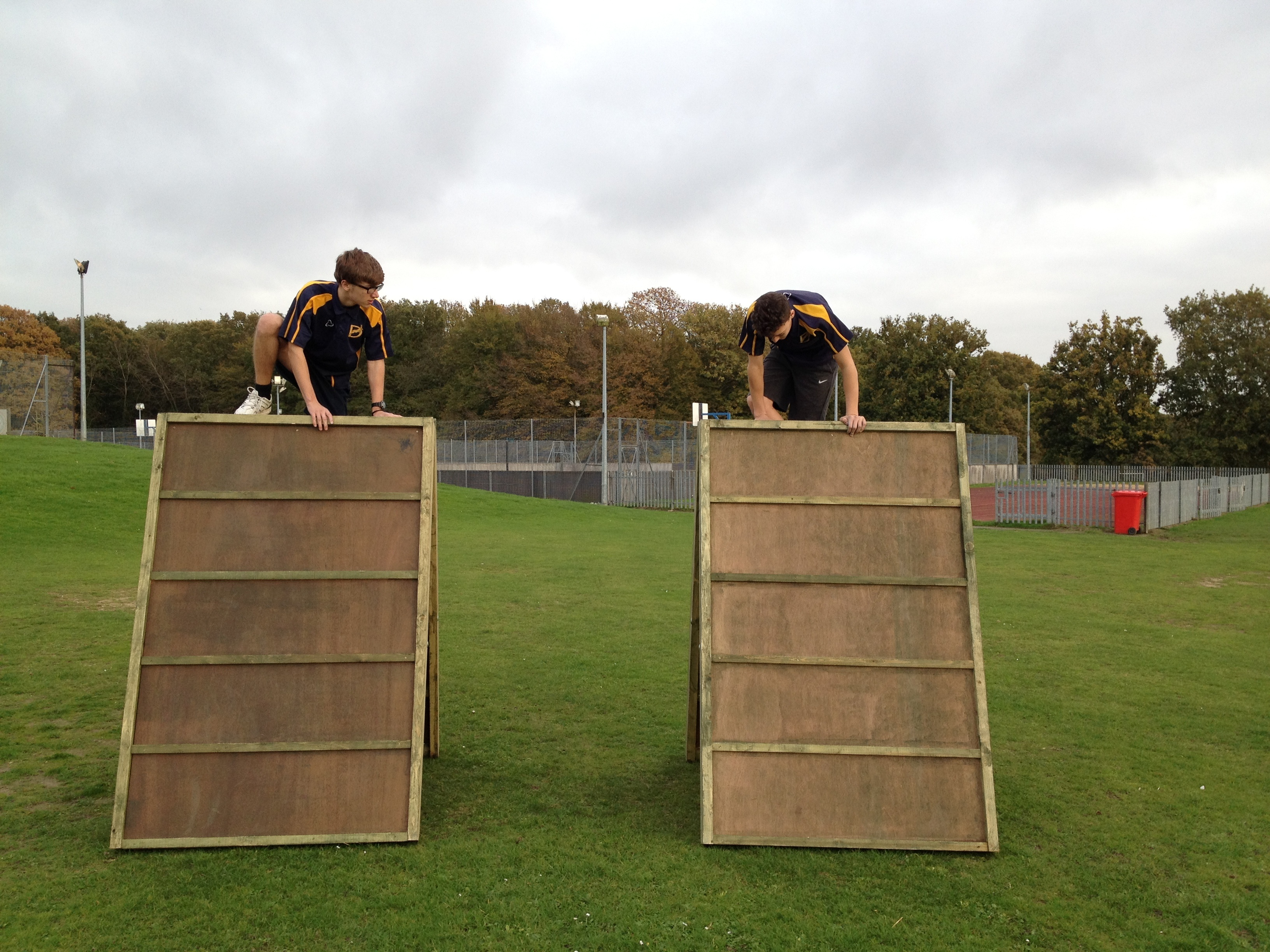 Children On Obstacle Course Equipment