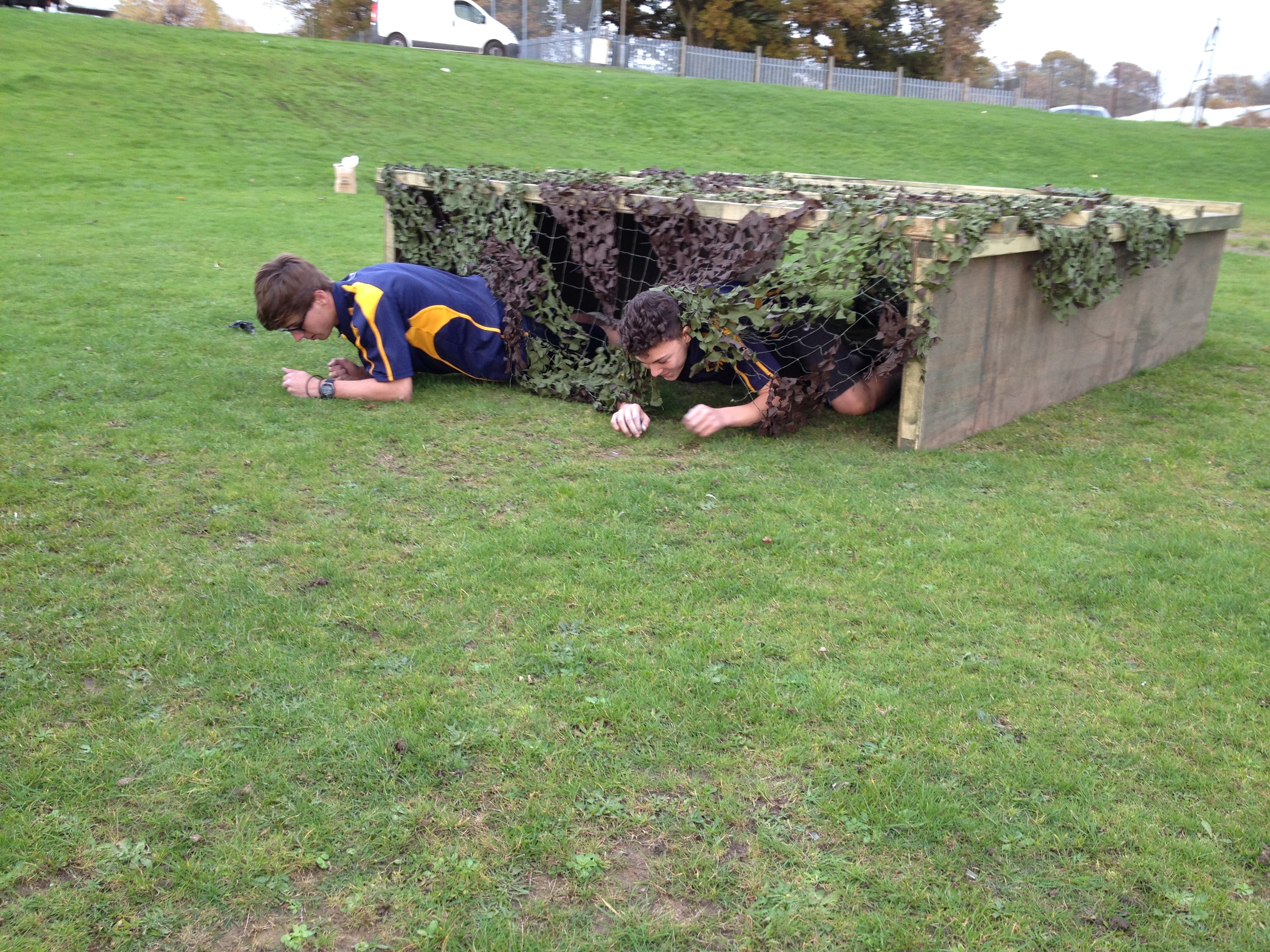 Children Climbing Through Army Style Obstacle Course