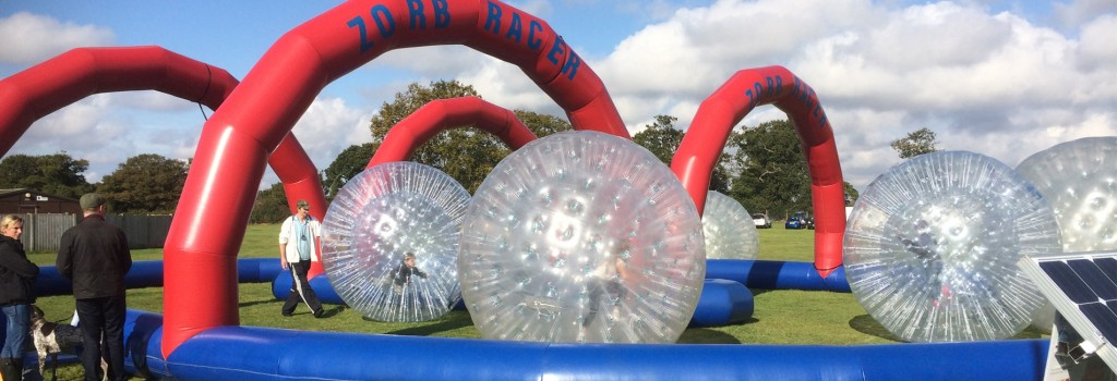 People Taking Part In Zorb Racing