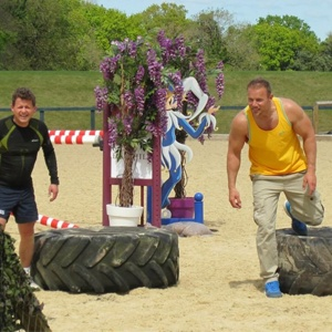 Adults Participating In An Obstacle Course