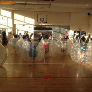 Children Playing Zorb Football On Sports Day