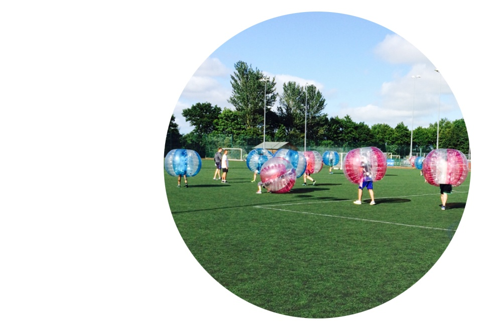 People Playing Bubble Football